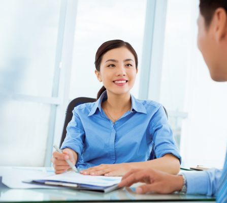 Pretty Vietnamese manager interviewing job candidate